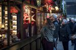Holiday shoppers browse a lighting booth at the Christkindlmarket in downtown Chicago, Illinois, U.S..