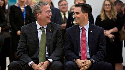 Jeb Bush shares a laugh with Scott Walker during a gathering of Wisconsin's school choice programs at La Casa de Esperanza in Waukesha, Wisconsin, on Nov. 9, 2015.