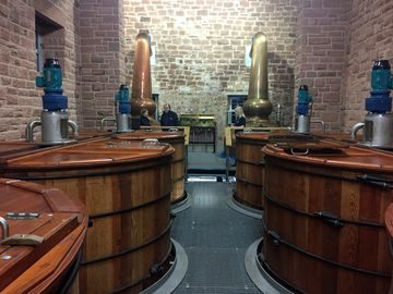 Where the action is at Annandale: mash tuns, washbacks and copper stills with whisky at different stages of production.