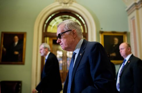 Senate Minority Leader Harry Reid, D-Nev., makes his way to a news conference after the Senate Policy luncheons in the Capitol, March 24, 2015.