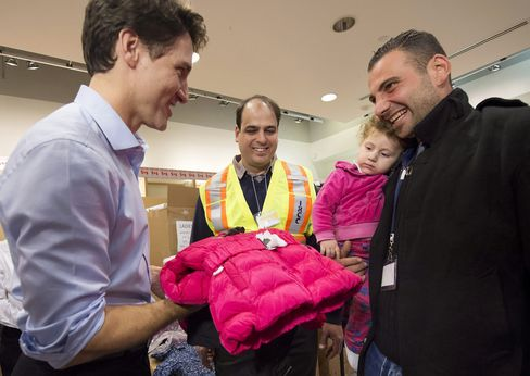 Trudeau greets refugees from Syria