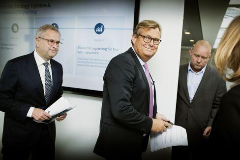 Michael Pram Rasmussen, center, and Soren Skou on Sept. 22.