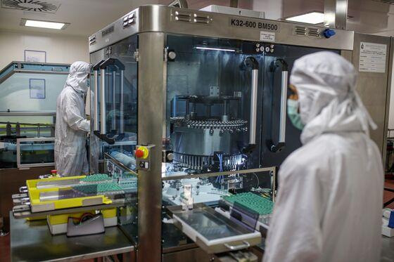 Pfizer's Vaccine Windfall; Singapore Cracks Down: Virus Update