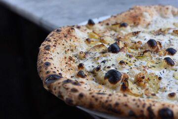 The vegetarian roast potato pizza at Pizzicletta also includes smoked garlic.