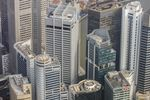 Commercial buildings stand in the central business district in this aerial photograph taken above Singapore.