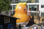 The Trump Baby sitting team give the six metre high inflatable TrumpBaby his first London outing inside the disused North London playground, Islington, London.