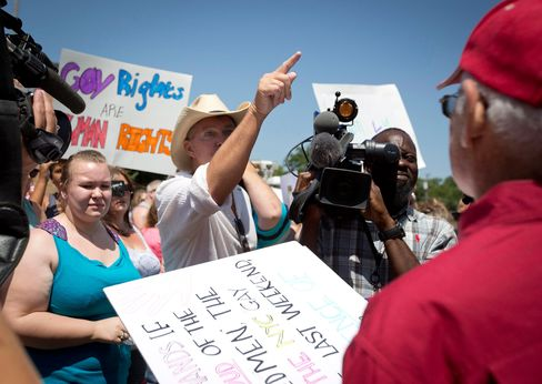 Joe Stapleton, center, and Neill Wilkerson, right, exchange words during at the courthouse in Granbury, Texas, on Thursday, July 2, 2015, amid dueling same-sex marriage rallies.