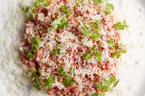The beef tartare, under a snow of smoked cheddar, is exquisite.