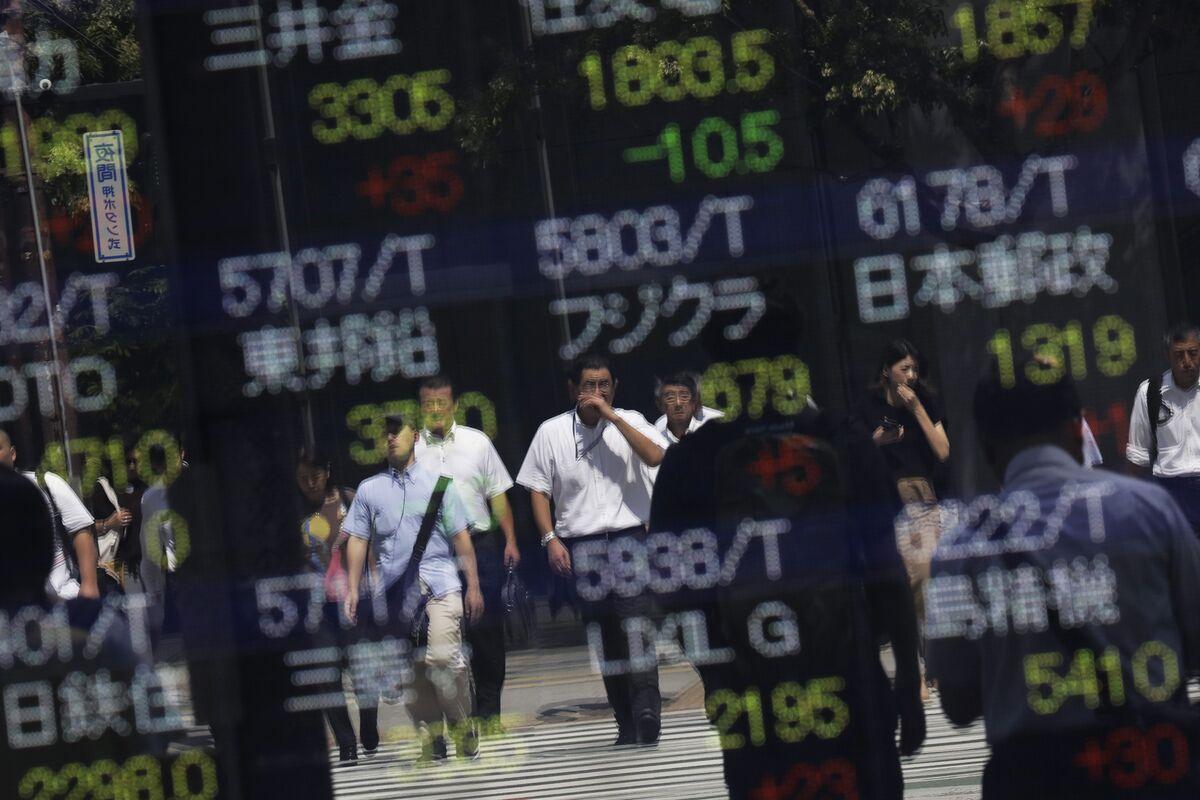 'Tsunami of Risk Aversion' Ripples Through Asian Stock Markets