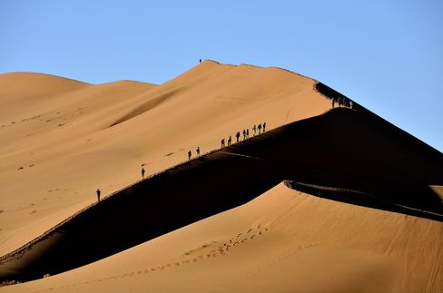 Hiking along dunes in the Namib Desert.