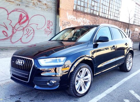 The Audi Q3 has smooth side lines and Audi's distinctive front grille.