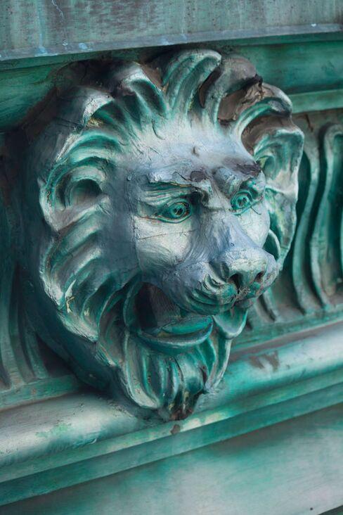 Copper lion heads, restored from the original 1906 Knickerbocker hotel, line St. Cloud's Beaux-Arts facade.