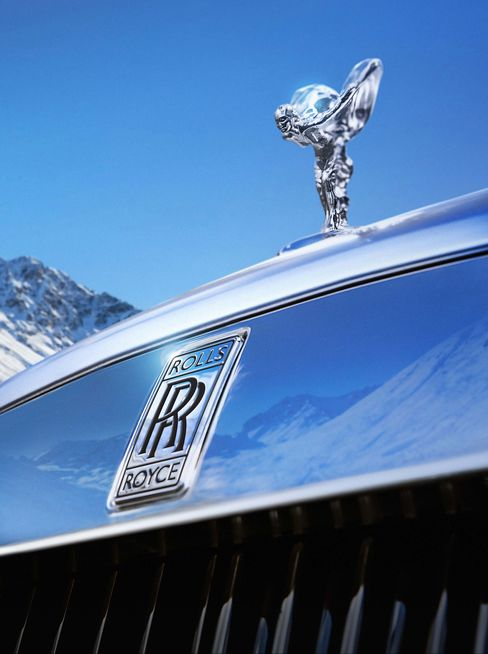 Mountainside with Rolls's iconic Spirit of Ecstasy hood ornament.