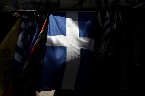 A Greek National Flag Hangs Outside a Street Kiosk in Athens