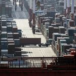 A truck transports a container at the Yangshan Deep Water Port in Shanghai, China.