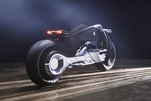 The bike is minimal to look at except for a fat rear tire and, beneath the carbon seat,two fine, red, illuminated strips that form the rear light and indicators.