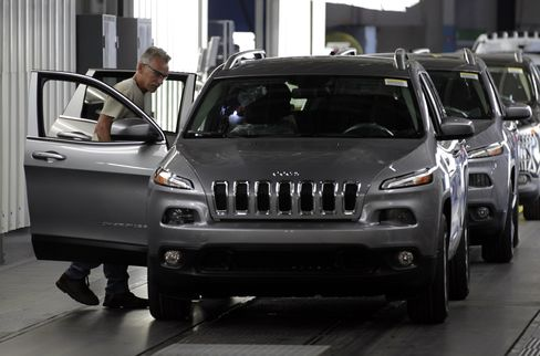An Employee Checks a Jeep Cherokee at the Chrysler Toledo Plant