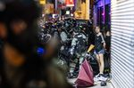 Riot police detain demonstrators during a protest on Hennessy Road in the Causeway Bay district of Hong Kong, China.