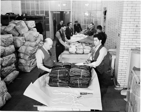 Packaging the finished product, 10th Avenue and 36th Street, 1937.