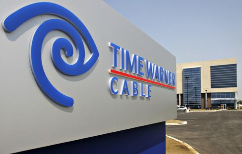 Time Warner Raises Forecast