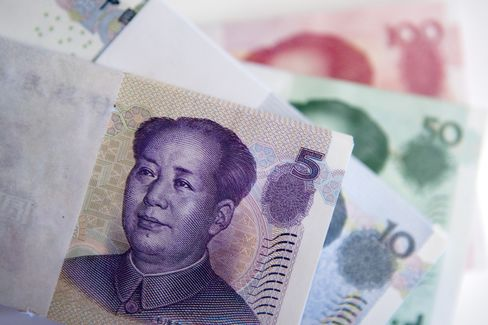Yuan Jumps Most Since April on U.S. Downgrade, Record Fixing