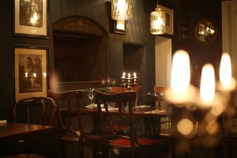 The basement dining room at Kitty Fisher's is cosy, like a country pub. It features historical details, such as an old bread oven.