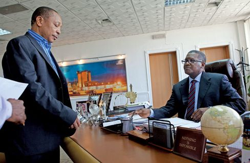 Dangote (seated) at his office in Ikoyi, a Lagos suburb