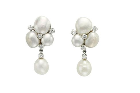 Cultured pearl and diamond ear clips.