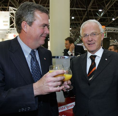 Jeb Bush and Juergen Ruettgers, then the minister-president of North Rhine-Westphalia, have a drink after inaugurating the Medica 2005 trade show in Duesseldorf, Germany.