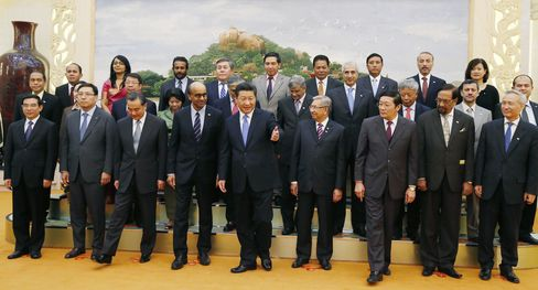 Chinese President Xi Jinping, center, and representatives of countries ready to join the Asian Infrastructure Investment Bank line up for a group photo at the Great Hall of the People in Beijing.