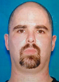 The mug shot handed out by the FBI of the suspect Wade Michael Page