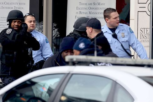 Suspect Is Charged in St. Louis B-School Shooting