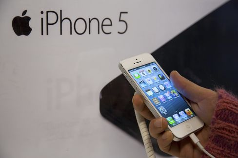 Apple May Face First Profit Drop in Decade as IPhone Slows