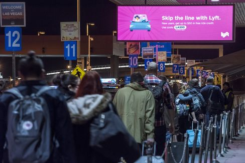 Passengers stand in the taxi line at McCarran International Airport in Las Vegas, on Jan. 3.
