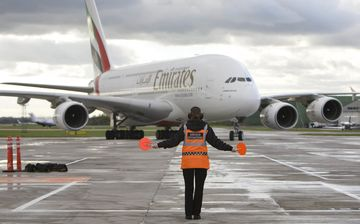 An Emirates Airbus A380 is directed at Manchester airport in Manchester, U.K.