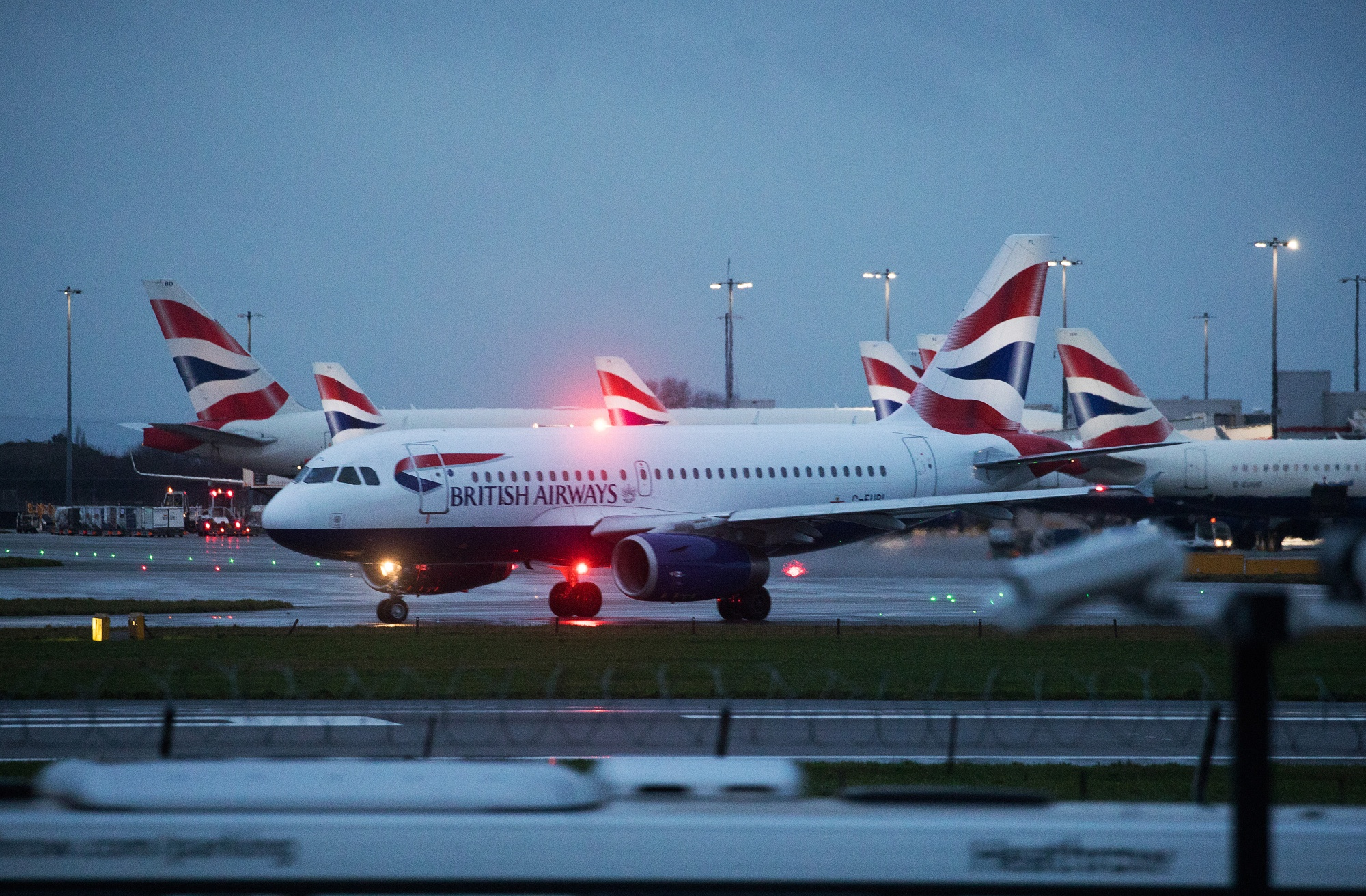 Aircraft operated by British Airways on the runway at London Heathrow Airport.