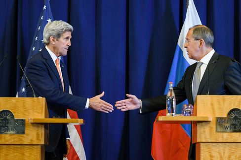 John Kerry and Sergei Lavrov shake hands in Geneva on Sept. 9.