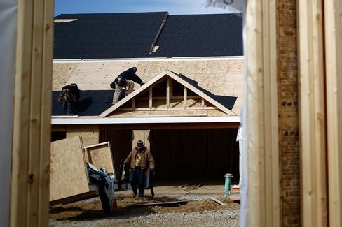 Roofers work at an apartment building being built in Lexington, Kentucky.