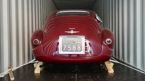 Specialty shippers will use soft straps (rather than chains or ropes, which can damage paint) for transporting precious finds such as this Ferrari 212.