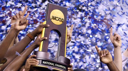 The Duke Blue Devils hold up the championship trophy after defeating the Wisconsin Badgers in the NCAA title game on April 6 at Lucas Oil Stadiumin Indianapolis.