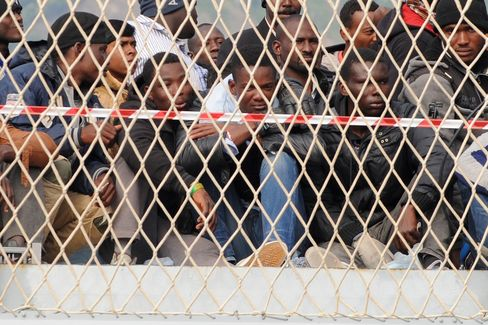 Migrants Wait to Disembark from a Ship in Italy