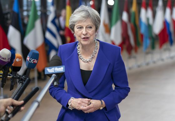 May Says U.K. Could Extend Brexit Transition to Ease Deadlock