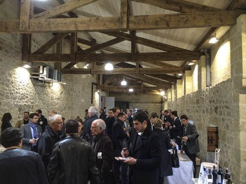 Merchants crowd one of the many en primeur tastings held last year in Bordeaux for the 2014 vintage.