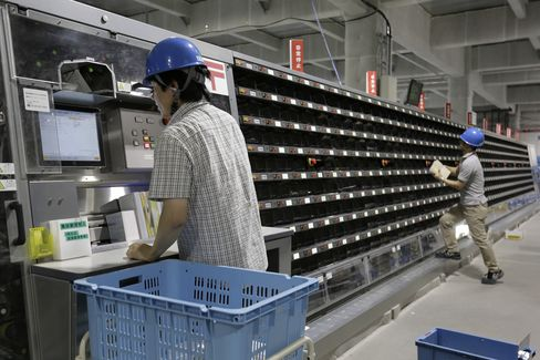 Japan Post employees sort mail