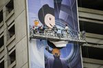 Workers install a billboard for GitHub Inc. in San Francisco.