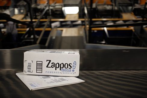 A Zappos package moves down a conveyor belt at a UPS facility.
