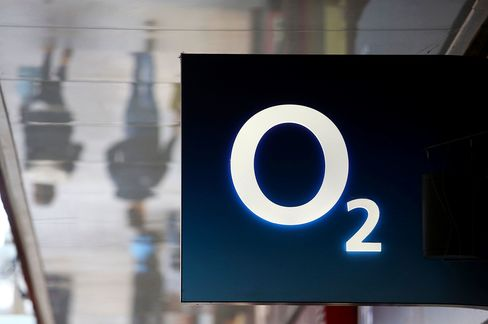 The O2 logo outside a mobile phone store in Colchester, U.K.