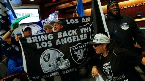 Raider and Chargers fans gathered for a 'tail gate' party and rally before marching to Carson City Hall to support the building of a stadium that would house the two NFL franchises, on April 21, 2015.