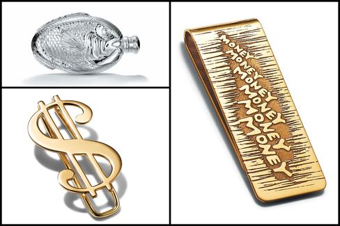 "From top left, clockwise: Fish flask in sterling silver, price upon request; ""Money"" money clip in 18-karat gold, $2,900; ""$"" money clip in 18-karat gold, $2,900."