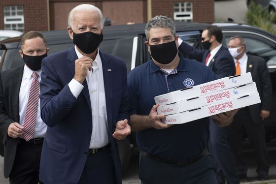 Biden Offers Quip to a Heckler, Pizza to Allies: Campaign Update